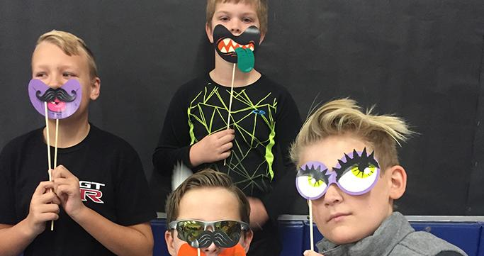 Wixom Prime Time Care students playing with masks.