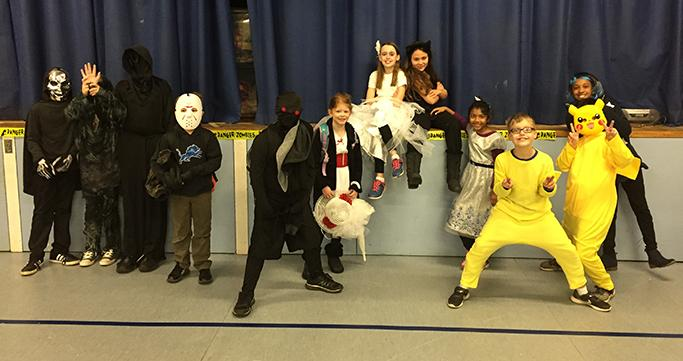 Wixom Prime Time Care students in costume on Halloween.