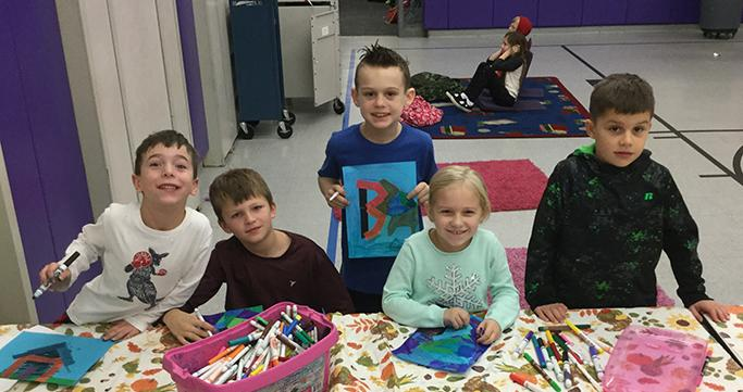 Prime Time Care students at Commerce Elementary enjoying crafts.