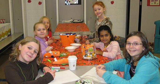 Prime Time Care students at Walled Lake Elementary enjoying crafts.