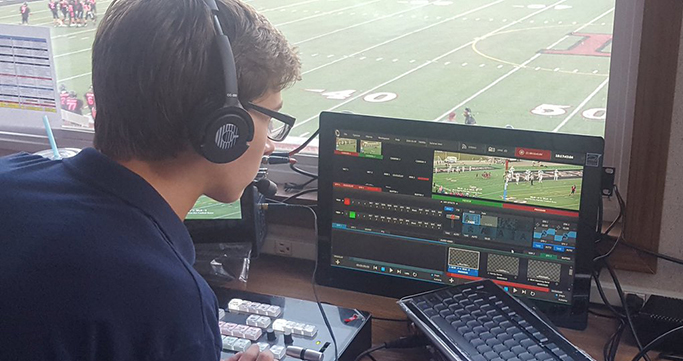 WLTV students directing a football game broadcast.