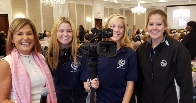 Students filming a event