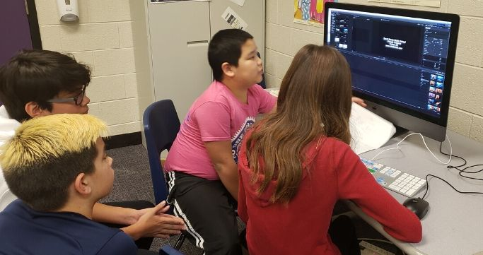 students editing video