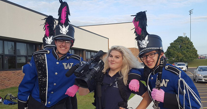 WLTV member with members of the WLW Marching Band